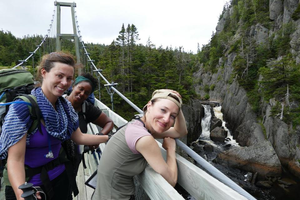 The group enjoys a relaxing moment near the end of the East Coast Trail hike.